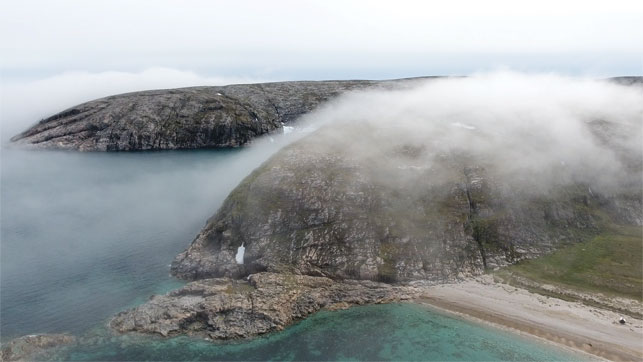 The impressive cliffs of Coats Island. RIGHT: The island is more than 100 kilometres  from the nearest community—and 60 kilometres from the nearest landmass.