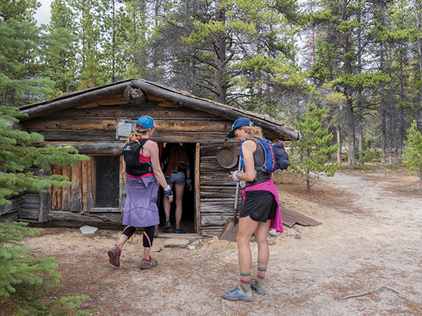 rail runners take a break and explore an old cabin.