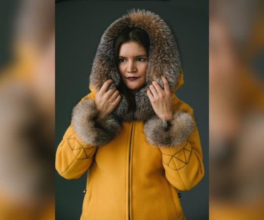 Itoah Scott models one of Papatsi Anrango Kotierk's parkas.