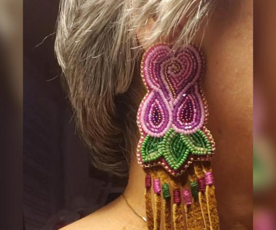 A model shows off a pair of earrings from Sharon Vittrekwa