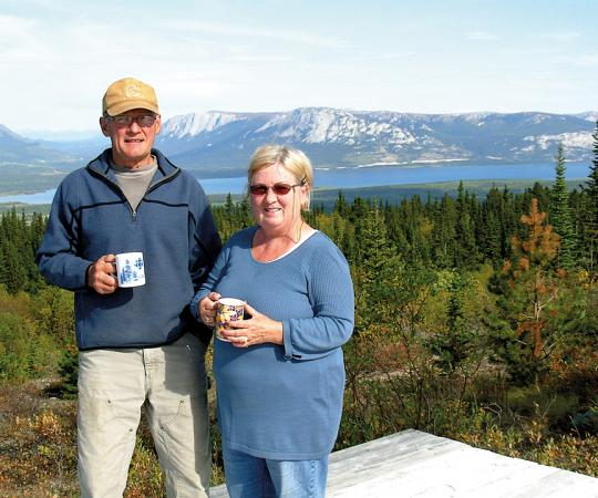 Jim Fowler with his wife Jacquelin in 2009, with the Yukon's Tagish Lake in the background. Photo courtesy of Gord Yakimow