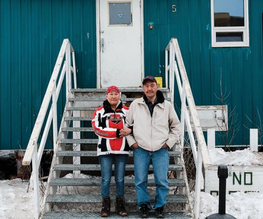 "Lorraine Raymond and James Harry on the steps of the John Wayne Kiktorak Centre. ""Once we're out of here, I'm going to work my ass off to keep us out of here,"" says Harry. ""Right now, a priority is finding a place to stay. And getting a ring for her."""