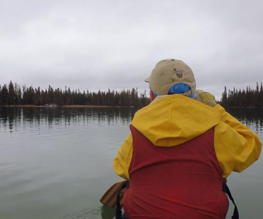 Paddling out to secret weekend camping spots at Hidden Lake, NWT. Photo by Tim Edwards