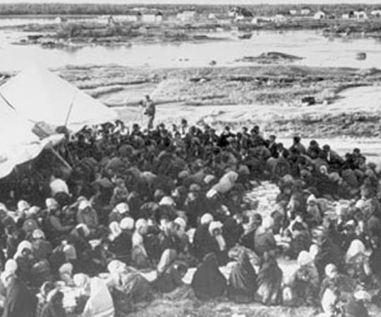 Crowds assemble on Treaty Day in Fort Rae, NWT, in the 1930s. Photo courtesy of Glenbow Museum NA-3844-58