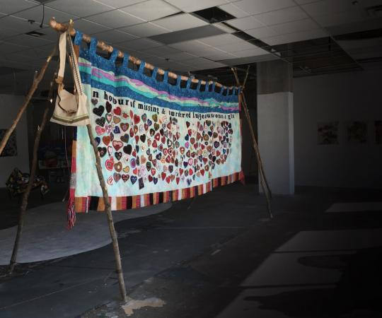 A quilt created by a communal effort, hosted by the Native Women's Association, in honour of missing and murdered Indigenous women and girls, was the centrepiece of last year's Social Fabric show.