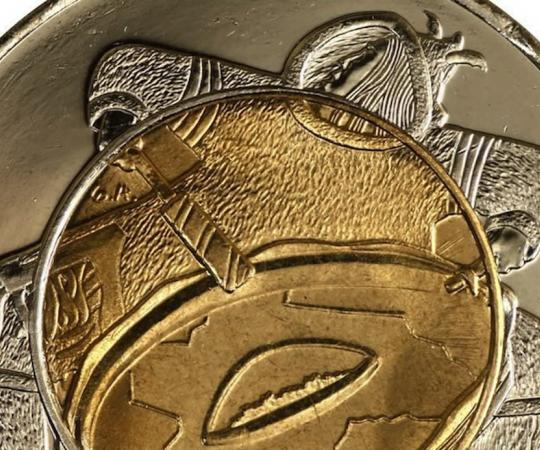 Inuk artist Germaine Arnaktauyok created the illustraition for the Nunavut 1999 coin.