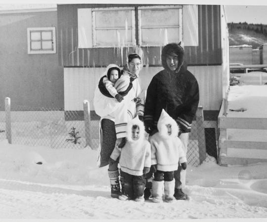 The Tootoos' 1965 Christmas portrait, with baby Victor in the author's amauti, Jennifer, the oldest, in front of her father, and in the middle, a restless Hunter. Photo Courtesy Sally Luttmer